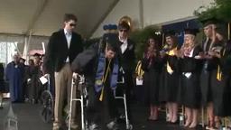 Paralyzed student, Austin Whitney, walks at graduation